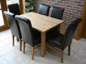 Minsk Solid Oak Dining Table shown with Brown Emperor chairs