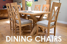 Solid oak dining chairs with real leather seat pads