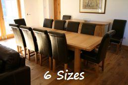 The stunning Tallinn European oak table.  Shown with the Titan leather chair @ �99.99 each