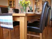 Tallinn Butterfly table and Emperor full leather dining chairs