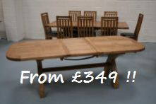 We have a limited number of the solid American oak chunky oval cross leg tables for sale a just £349 with a slight repair below the table top that means the extension needs a little help when aligining the pins to close the table.